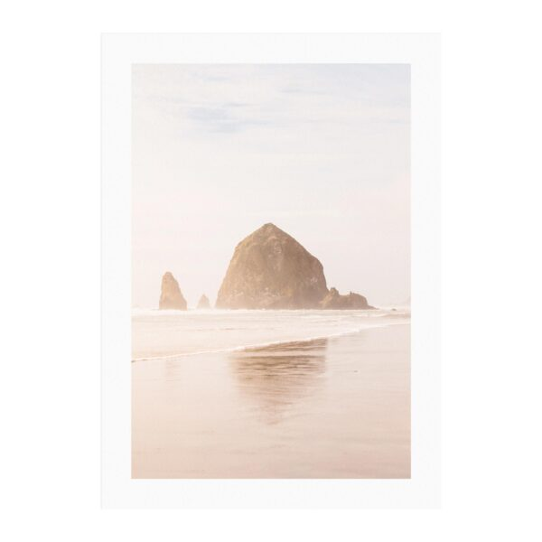 Product image of a print with white borders of Haystack Rock and reflection on the Pacific Ocean in Cannon Beach, Oregon by photographer Brandon Lopez