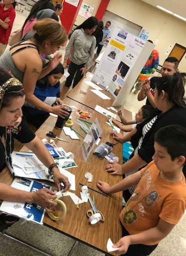 Students and CIS staff during the Kreuger Middle STEM Family Night in San Antonio, TX.
