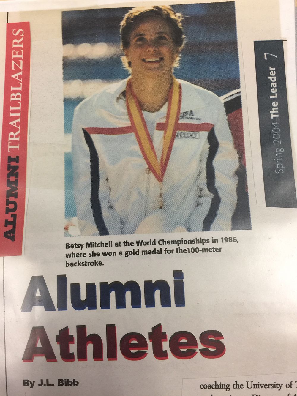 Front page of an article about Betsy's 1986 World Champions gold medal win, in Spain, for the 100-meter backstroke.