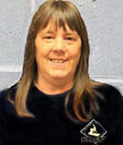 An image of Nancy Milani, the Preventive Maintenance Manager, is displayed.