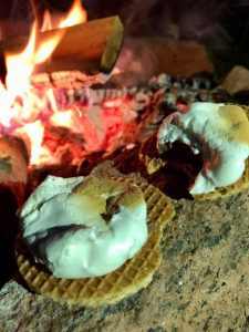 dutch s'mores in front of campfire at night
