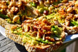 toast with smashed avocado and nuts