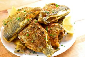 plate piled with fried panfish