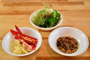 three bowls with pickling ingredients