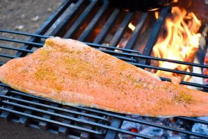 salmon fillet cooking over fire