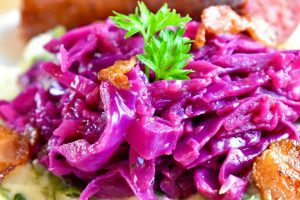 braised red cabbage and apple with a sprig of parsley on top