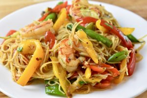 shrimp, green beans, and peppers on noodles