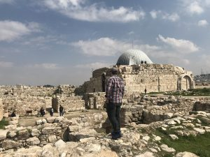 man standing on ruins