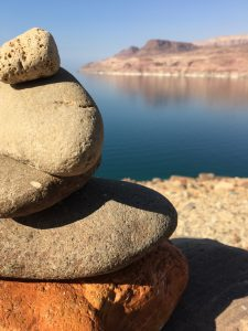 stacked rocks in front of the dead sea