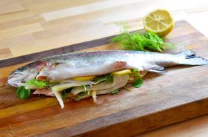 whole raw trout stuffed with lemon and fennel