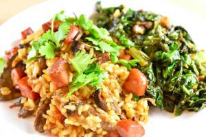 Portuguese duck rice with sauteed kale