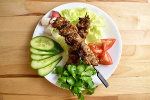 grilled beef skewers with fresh vegetables