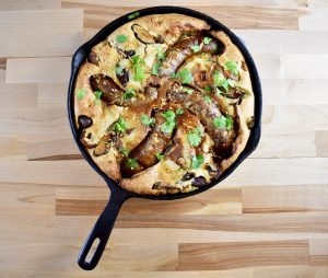 toad in the hole in a cast iron pan