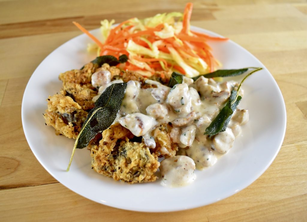 country fried goose gizzards with sausage gravy and salad