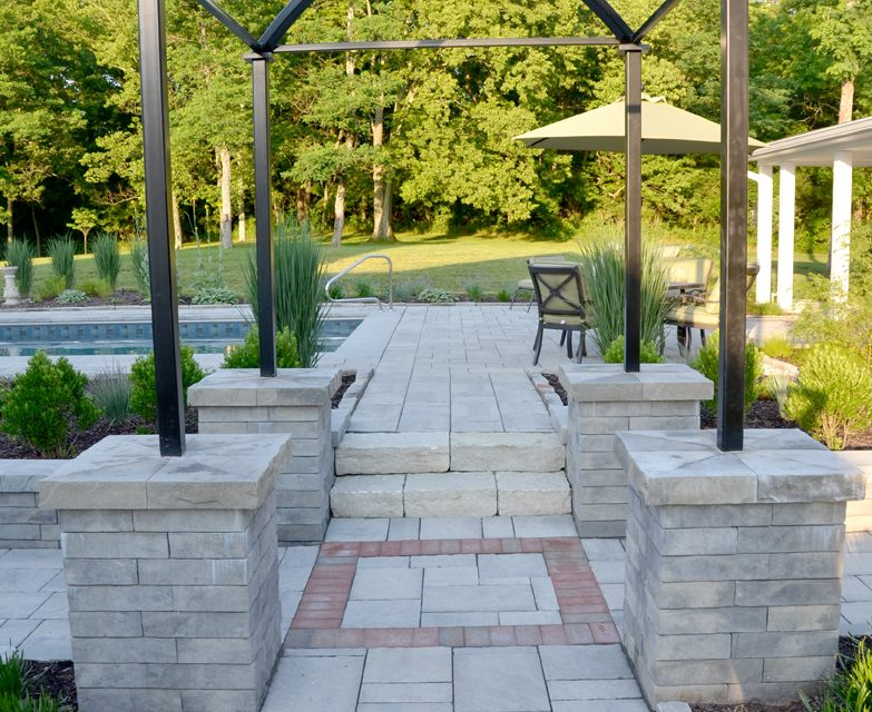 Create an inviting entrance with pavers, brick and stone