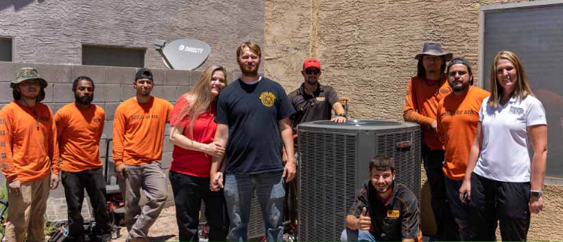 Mesa Officer Sean Stoddard and his wife Rebecca Receive Free Trane AC System
