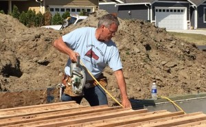 """Jon helping to build a home in the new """"self help"""" neighborhood on South Church Road"""