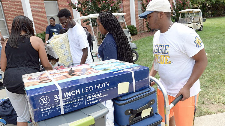 New residents use their dorm check list for Freshman move-in day at North Carolina A&T State University.
