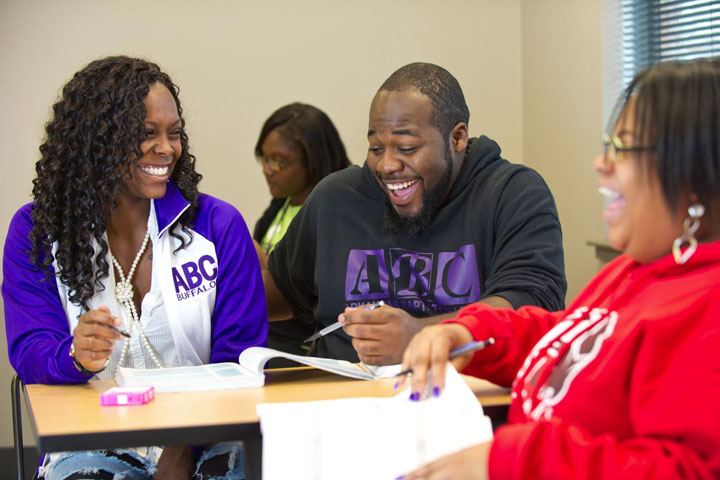Three Arkansas Baptist College students joke during one of many group projects they will participate in during the semester.