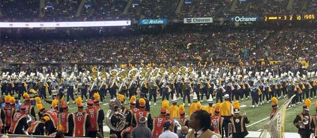 The Grambling State University Band wait on the sidelines to take the field as Southern University's Band performs in formation during the 2013 halftime show.