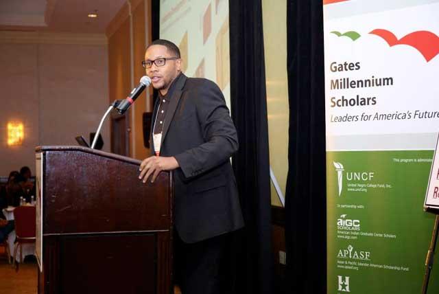 Presenter Ryan Davis speaks at the podium at the 2013 Gates Millennium (Bill Gates Scholarship) Freshman Leadership Conference at the Marriott in Virginia.