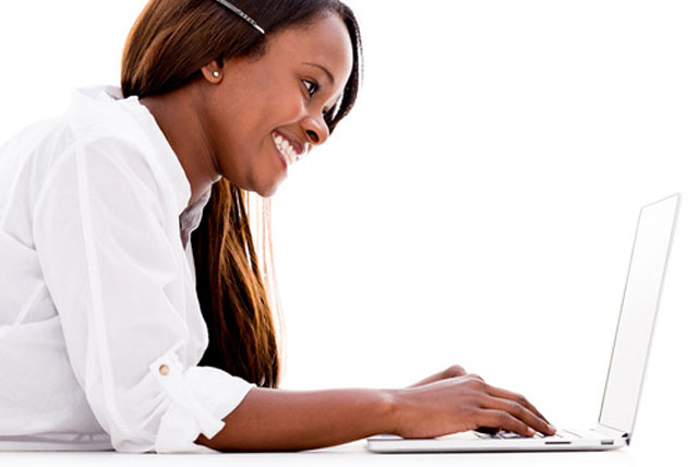 African-American Female student using a laptop to fill out FAFSA Application online.