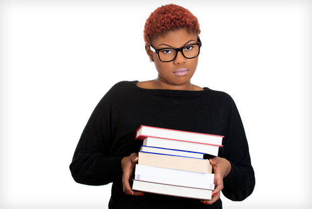 Sad African-American female student considers becoming a college dropout.
