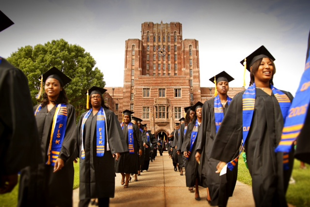 What is an HBCU? The letters HBCU are an acronym that for Historically Black Colleges and Universities. Pictured are graduates march out of the Cravath Hall building at Fisk University, a private HBCU in Nashville, TN.