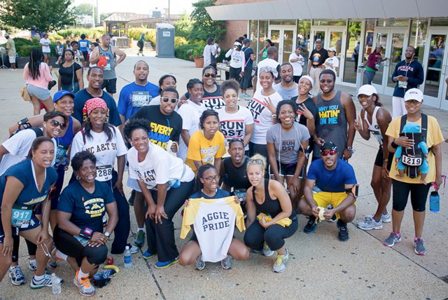 Group of HBCU alumni take a group photo after 2013 HBCU 5k race.