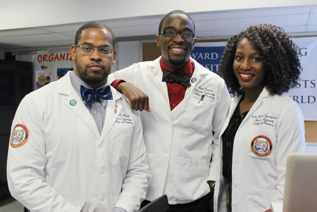 Three APhA-ASP Howard University College of Pharmacy Students pose together in Washington, DC.