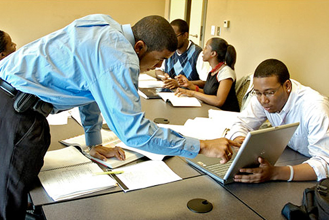 The Howard University School of Business students collaborating on a group project.