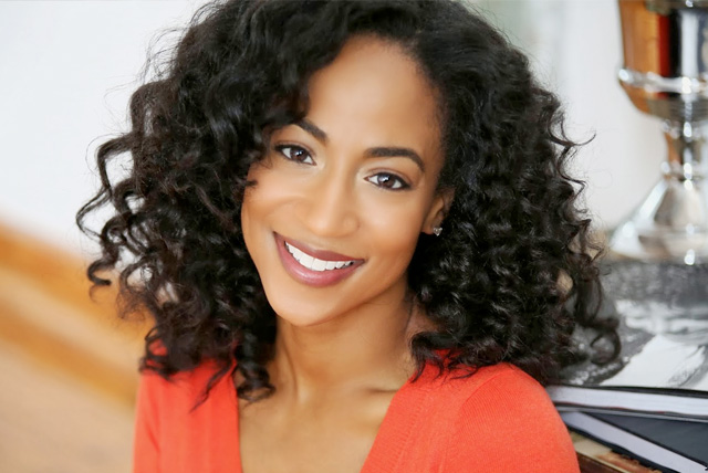 """Africa Miranda, was born in Boston, MA and raised in Montgomery, AL. Africa is the Star of Bravo's TV show """"The New Atlanta,"""" a commercial print model, and actress. She is the Face of natural hair campaigns for Creme of Nature and ORS Curls Unleashed."""