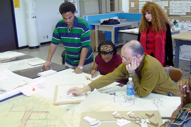 Prairie View A&M students review their project with professor in an Architecture Design Studio class.