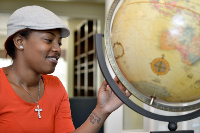 HBCU Liberal Arts College Rankings: A Johnson C. Smith female French language major looks at a globe in the media center. JCSU has been recognized as one of the top-ranked liberal arts colleges in 2014 by Washington Monthly magazine.