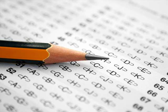 Close up of pencil on answer sheet for college entrance exam.