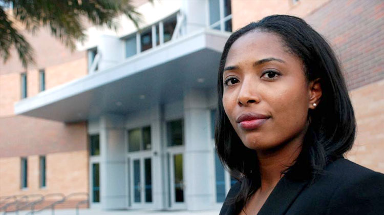 Law student Herrittaccei Shabazz stands in front of the FAMU College of Law building in Orlando, Florida.