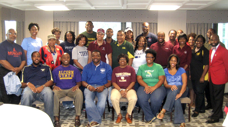 Members of The DC Metro HBCU Alumni Alliance (DCHBCUAA) pose for a group photo wearing various black college T-shirts in Washington, DC.