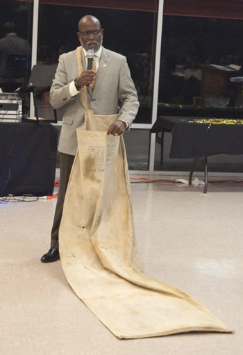 Charlie Nelms displays a six-foot cotton sack from fields of the Arkansas Delta during the 45th UAPB class reunion.