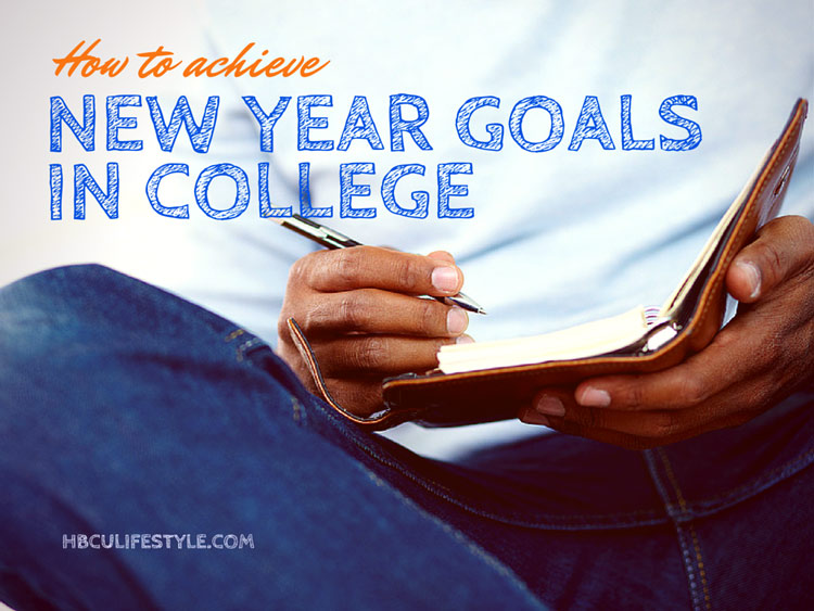 Hands of a young African American male student writing his New Year goals in a notepad.