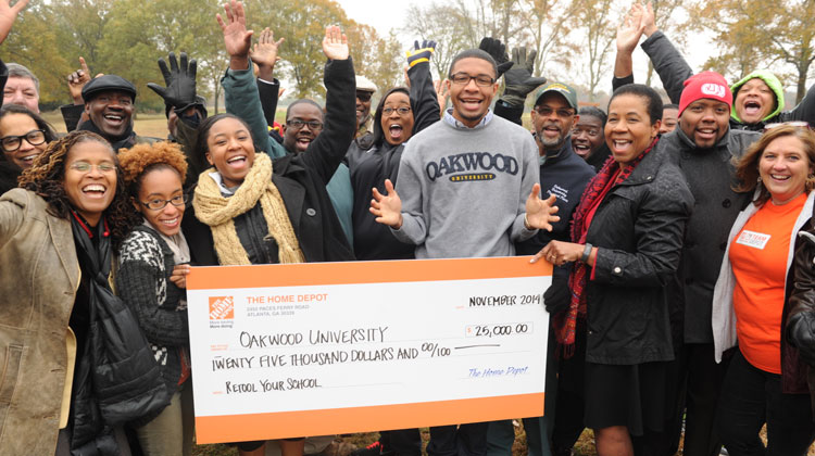 Oakwood University students and faculty celebrate winning one of the 2014 Retool Your School Campus Improvement Grants.