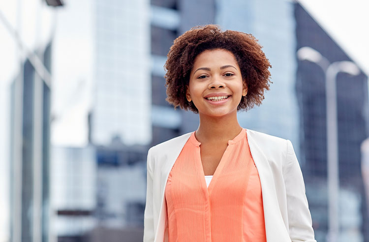 Young smiling HBCU graduate seeking a job in the city