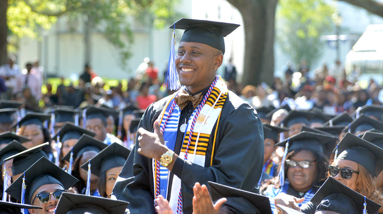 HBCU vs PWI Employment Debate: A graduate at 2016 Dillard University Commencement is recognized during the ceremony.