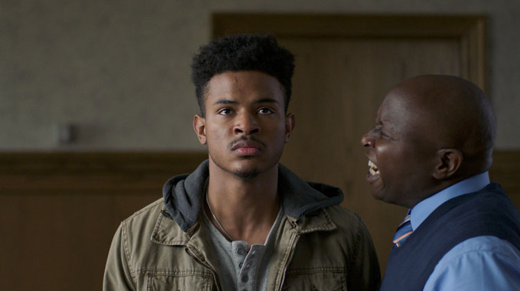 A scene from the film 'Burning Sands,' featuring actors Trevor Jackson and Steve Harris.