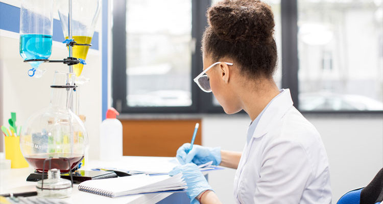 Young female African American scientist in corporate laboratory