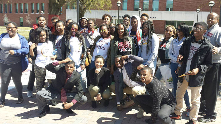 MTM HBCU Tour students pose with Black Greek fraternity members on the campus of Howard University.