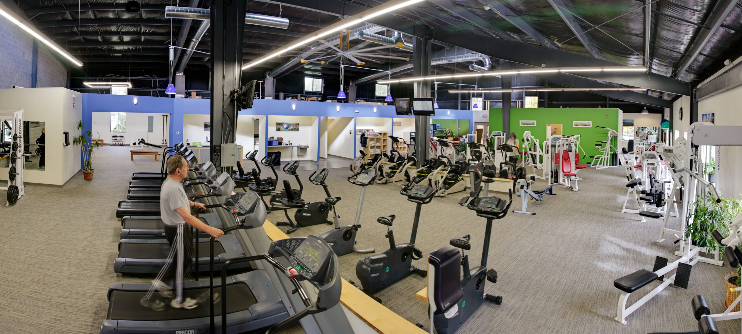 Cybex and nautilus strength training equipment along the windows with ample floor space for precor cardio - spacious facility