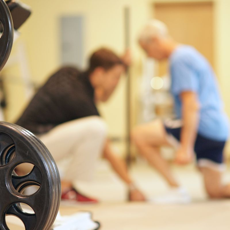 Exercise physiologist works with client on fitness assessment training