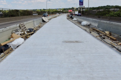 July 2020 - The contractor has begun paving the center area of the expressway.
