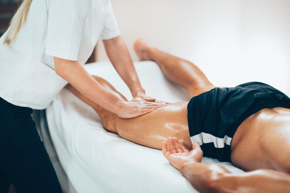 massage therapist massaging athlete