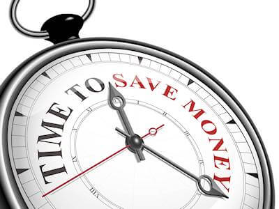 """""""Time to Save Money"""" printed on alarm clock"""